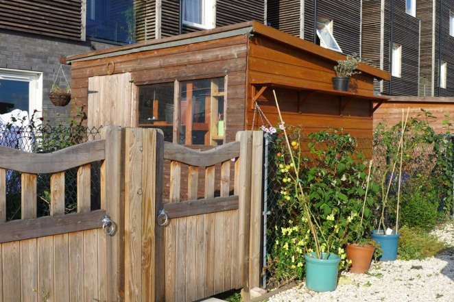 Each home comes with a greenhouse and garden shed to encourage residents to grow their own vegetables
